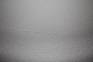 popcorn texture ceiling half scraped off to be removed by the texture king calgary