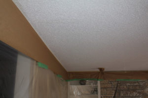 protecting the walls before ceiling texture with paper and plasic
